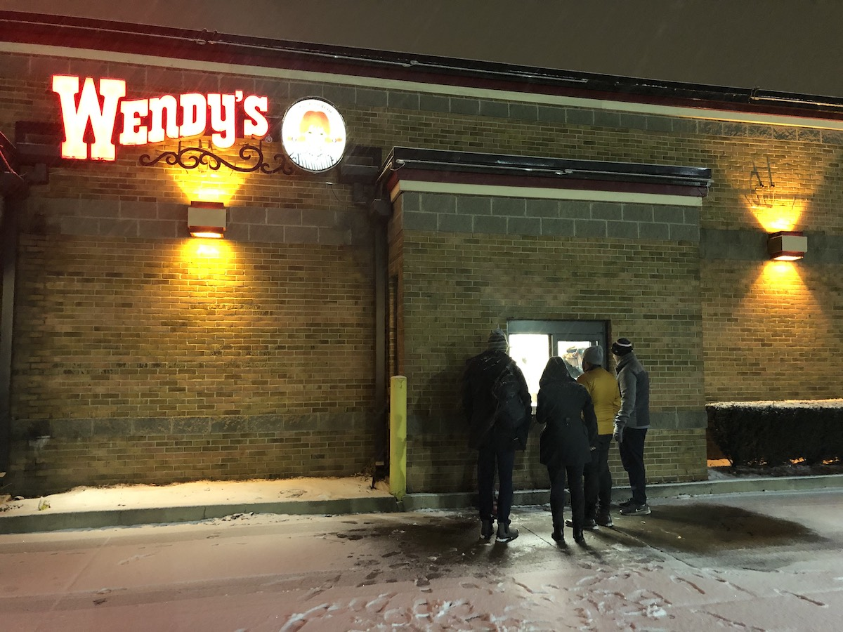 Picture of us huddled outside Wendy's trying to get food the night before our meeting